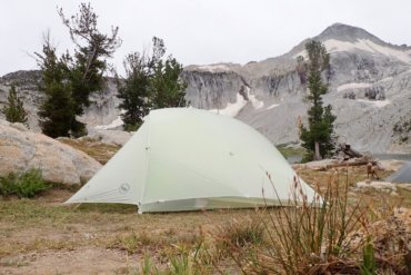 This photo shows the Big Agnes Fly Creek HV2 Platinum Tent set up near a mountain lake.