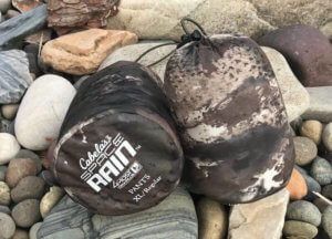 This photo shows the Cabela's Space Rain Jacket and Pants packed up in their included stuff sacks.