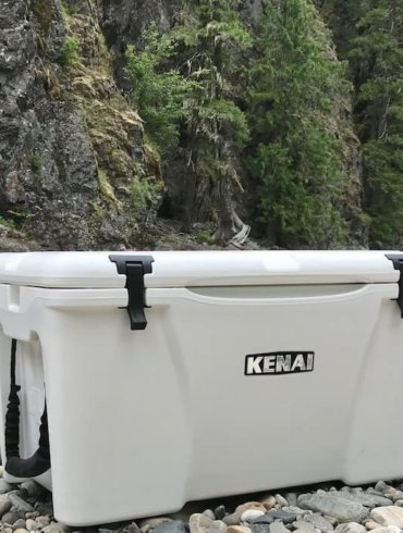 This photo shows the Grizzly Kenai 45 cooler on a river bank.