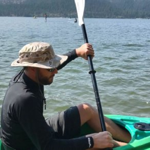This photo shows the author wearing the Shelta Seahawk hat in a kayak on a lake.