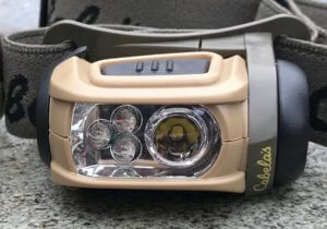 This best headlamp for hunting photo shows the Cabela's Alaskan Guide RGB Headlamp by Princeton Tec.