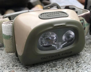 This best hunting headlamp photo shows the Petzl Tactikka +RGB Headlamp.