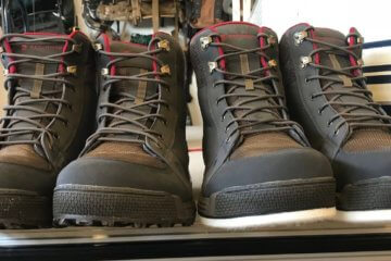 This photos shows the Redington Prowler Sticky Rubber Wading Boots next to the Redington Prowler Felt Wading Boots.