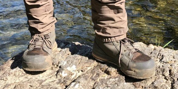 This photo shows the Redington Prowler Felt Wading Boots with Redington fishing waders.