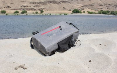 This photo shows the SEVENTY2 Survival System on a sandy beach.