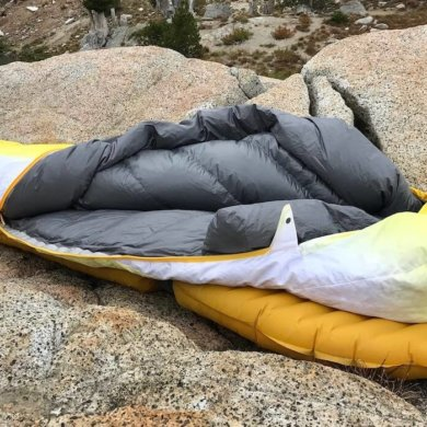 This photo shows the Therm-a-Rest Parsec 20 sleeping bag near a mountain lake.