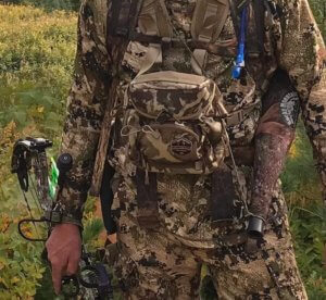 This photo shows the Alaska Guide Creations Classic MAX Pack Bino Harness worn on an archery hunter.