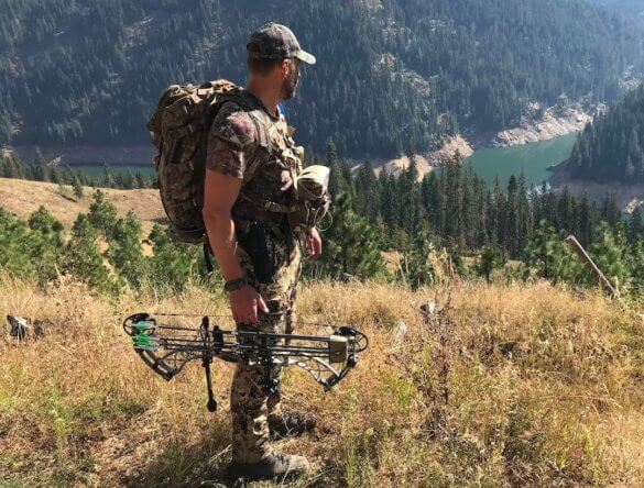 This photo shows the Alaska Guide Creations Classic MAX Pack Bino Harness on a hunter outside while hunting.
