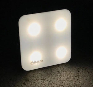 This best camping gift photo shows the BioLite SunLight Portable Solar Light lit up in the dark.