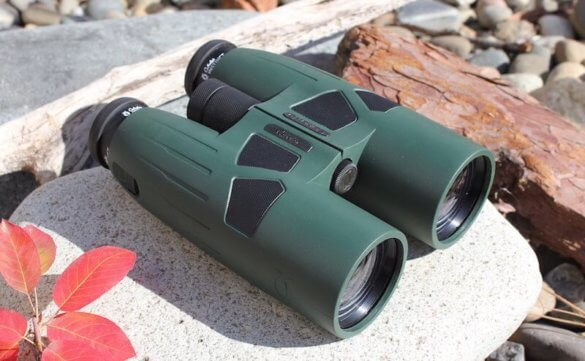 This photo shows a photo of a high-quality binocular on a rock.