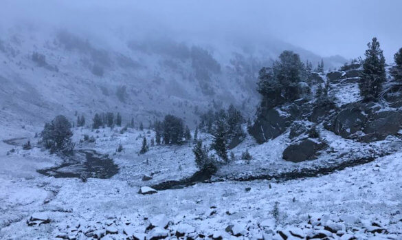 This photo shows the Eagle Cap Wilderness area with snow in August.