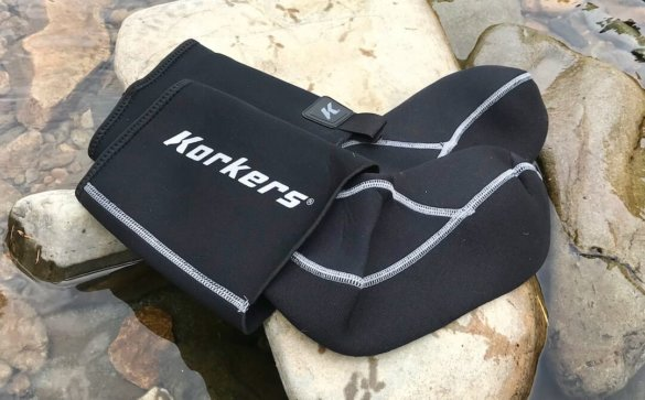 This photo shows the Korkers I-Drain Neoprene Guard Socks near a river.