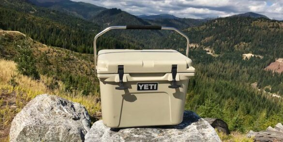 This photo shows the YETI Roadie 20 cooler outside on a rock.