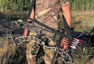 This bowhunting gift photo shows the Bow Buddy Bow Sling being used with a hunting bow.