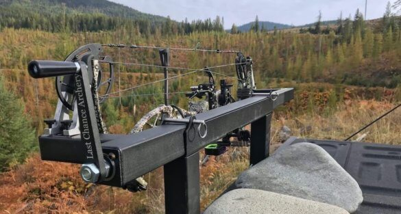 This photo shows the Last Chance Archery PACK-N-GO Portable Bow Press with a compound bow in the press.