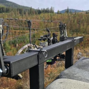 This photo shows the Last Chance Archery PACK-N-GO Portable Bow Press outside.