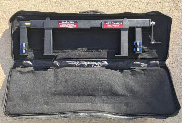 This photo shows the Last Chance Archery PACK-N-GO Portable Bow Press with its carrying case.