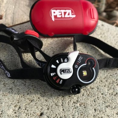 This photo shows the Petzl e+LITE Emergency Headlamp.