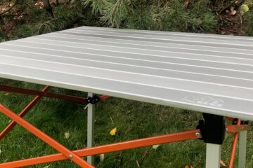 This photo shows the REI Co-op Camp Roll Table outside at a camping spot.