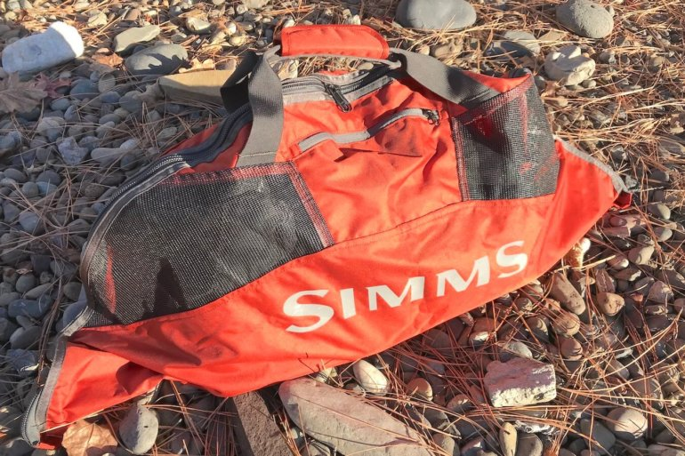 This photo shows the Simms Taco Wader Bag outside.