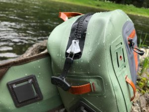 This photo shows a close-up of the TIZIP zipper on the Fishpond Thunderhead Submersible Lumbar Pack.