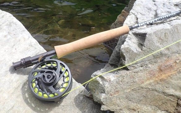 This photo shows the new Orvis Clearwater Fly Rod Outfit on a rock near a trout stream.
