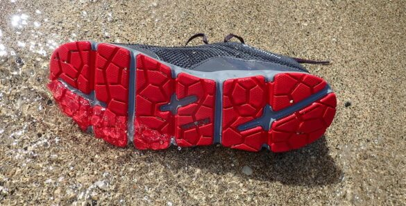 This photo shows the soles of the Columbia Drainmaker IV water shoes.