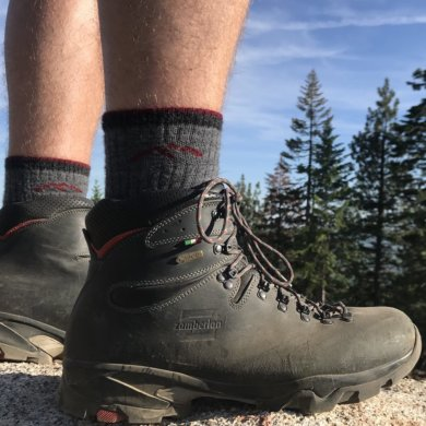 This Darn Tough sock review photo shows the Darn Tough Hiker Boot Sock Full Cushion Sock being worn by a hiker.