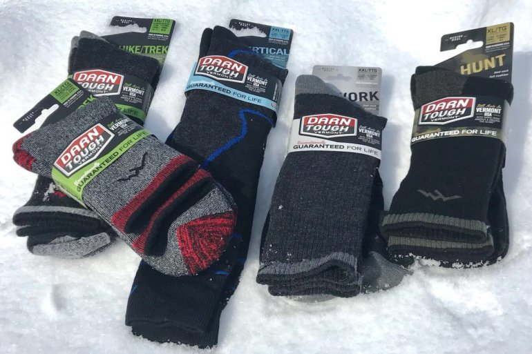 This photo shows five pairs of Darn Tough merino wool sock options.