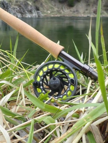 This photo shows the Orvis Clearwater Fly Outfit rod and reel near a river.