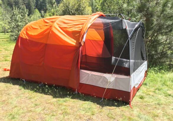 This photo shows the REI Kingdom 8 Tent with half the rainfly pulled back.