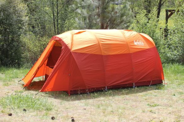 This photo shows the REI Co-op Kingdom 8 Tent set up in a camping spot.