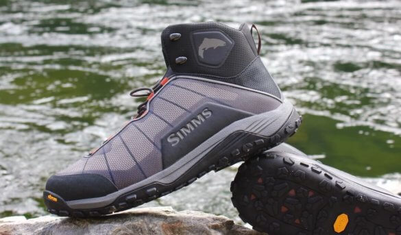 This review photo shows the side profile of the Simms Flyweight Wading Boots.