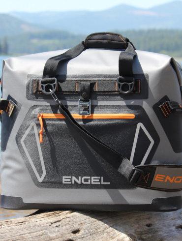 This photo shows the Engel HD30 cooler near a lake.