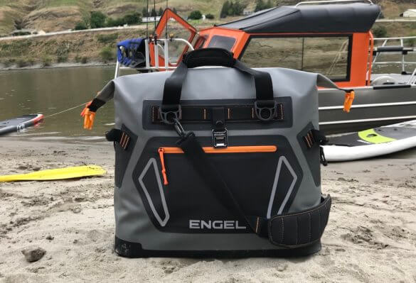 This photo shows the front of the Engel HD30 cooler on a beach.