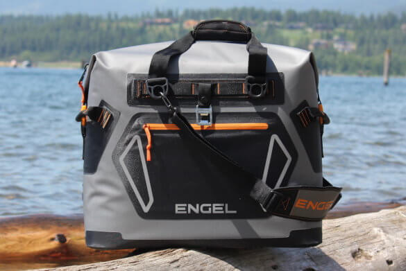 This review photo shows the Engel HD30 in a closeup outside near water.