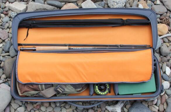 This review photo shows the Orvis Safe Passage Carry It All fly fishing travel bag case shows the section of the case that holds fly rods.