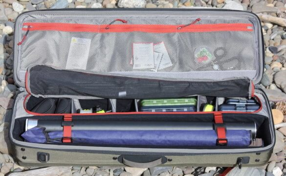 The review photo shows the interior of the Simms Bounty Hunter Vault Duffel with example fly fishing gear inside.