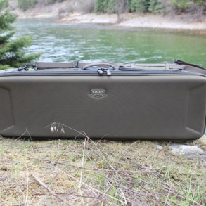 The review photo shows the Simms Bounty Hunter Vault Duffel outside near a river.
