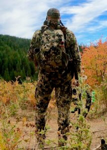 This photo shows the Mystery Ranch Mule hunting backpack on a bowhunter in a forest.