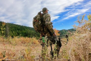 This photo shows a hunter wearing the Mystery Ranch Mule backpack outside.