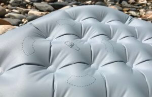 This photo shows a closeup of the Pillow Lock System placement on  the Sea to Summit Ether Light XT Insulated Air Sleeping Mat.