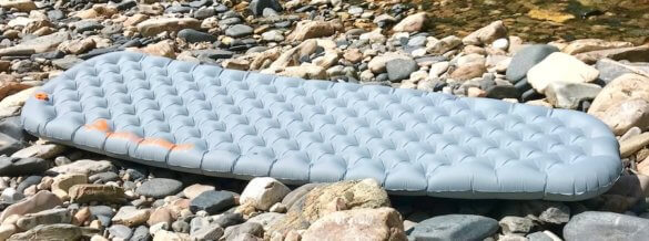 This photo shows the entire length of the inflated Sea to Summit Ether Light XT Insulated Air Sleeping Mat.