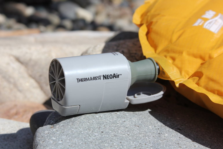 This photo shows the Therm-a-Rest NeoAir Mini Pump as it blows up a Therm-a-Rest NeoAir Xlite air mattress.