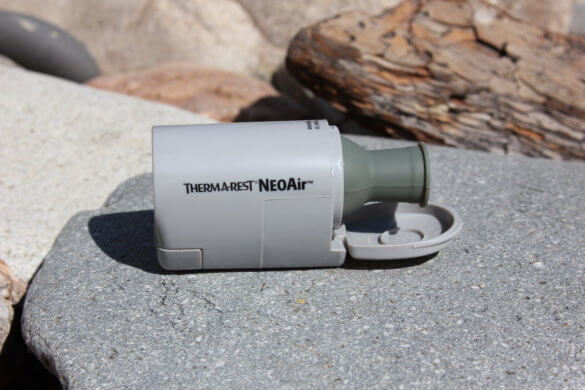 This photo shows the Therm-a-Rest NeoAir Mini Pump with the lid open.