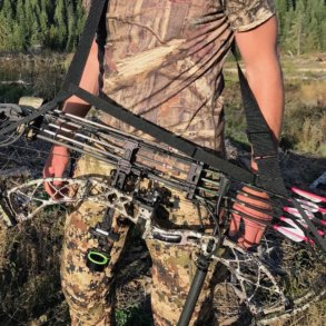 This photo shows a bowhunter wearing the Bow Buddy Bow Sling with a compound bow.
