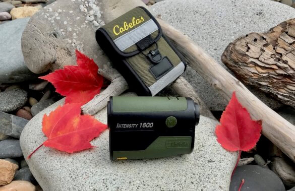 This review photo shows the Cabela's Intensity 1600 Laser Rangefinder with its case on a rock.