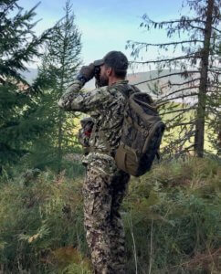 This photo shows a hunter using the Nexgen Outfitters Whitetail Caddy Pack.