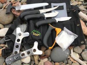 This hunting gift guide photo shows the Outdoor Edge ButcherLite.