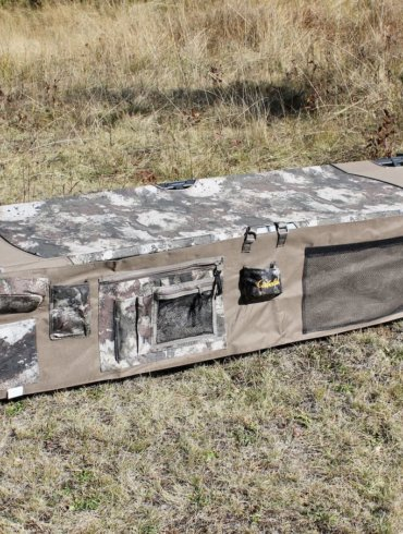 This photo shows the Cabela's O2 Octane Camp Cot with Organizer.